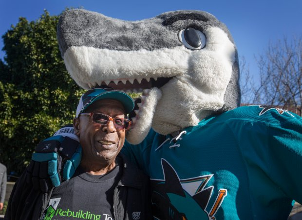 Isiah Breaux gets up-close with Sharkie, The San Jose Sharks mascot, as Rebuilding Together Silicon Valley and the Sharks Foundation work on the home of Breaux, 93, and his 95 year old wife in San Jose, Calif., Friday, Jan. 13, 2017. They have been living in their home since 1950. Breaux was a Marine, worked in the SJ Canneries, and was a welder for GE. He is in good health, and cares for his wife who has health issues. (Patrick Tehan/Bay Area News Group)