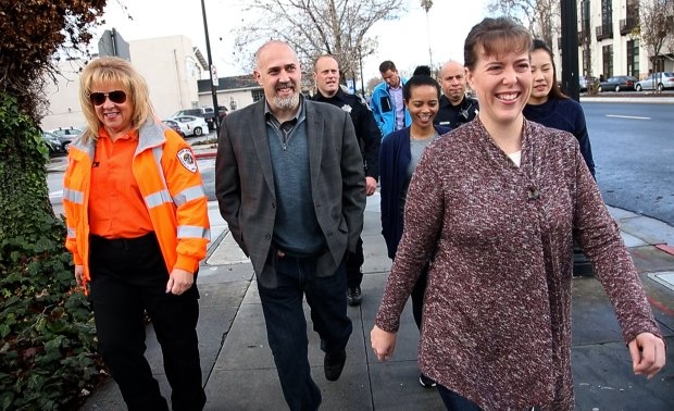 Seven weeks after collapsing from a heart attack while running in the Turkey Trot race, Mike Dosik, second from left, finishes the race walking with the people who helped save his life Wednesday, Jan. 11, 2017, in San Jose, Calif. Joining him (left to right) are Sue Sherrin of San Jose Search and Rescue, San Jose police Officer Justin Jantz, nurse Zenebue Tegegne, SJPD Sgt. Chris Dominguez, nurse Andrea Heiser, and nursing student Annie Ho. (Karl Mondon/Bay Area News Group)