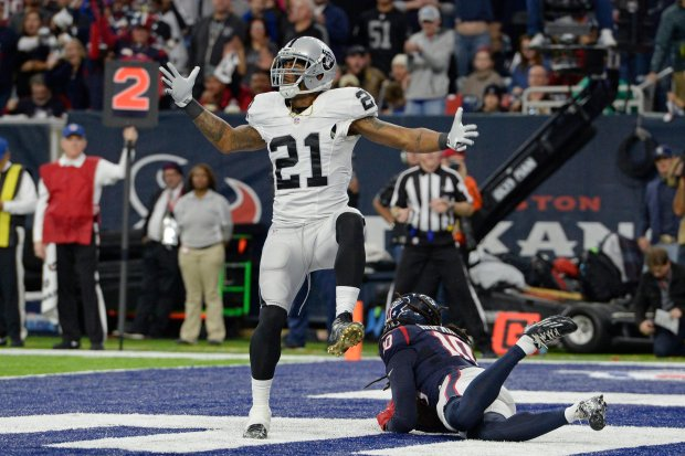 touchdown in front of Oakland Raiders' Sean Smith (21) reacts after Houston Texans' DeAndre Hopkins (10) catches a touchdown pass in front of him in the second quarter of the AFC West Wild Card round game at the NRG Stadium in Houston, Texas, on Saturday, Jan. 7, 2017. (Jose Carlos Fajardo/Bay Area News Group)