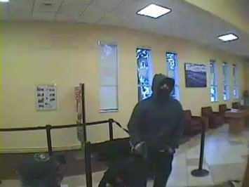 A surveillance image shows one of two masked men who robbed at gunpoint a Wells Fargo bank branch on Big Basin Way in Saratoga on Jan. 11, 2017.