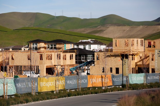 New homes are currently under construction along Wallis Ranch Drive at the Wallis Ranch housing development in the Tassajara Valley of Dublin, Calif., on Monday, Jan. 30, 2017. Undeveloped lands are still under the threat of urban sprawl according to the Greenbelt Alliance. (Gary Reyes/Bay Area News Group)
