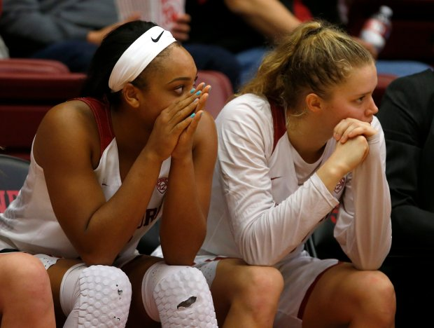 Stanford's DiJonai Carrington (21) and Stanford's Brittany McPhee (12) watch from the bench during the final moments of their 72-69 loss to the Oregon State Beavers in the second overtime at the Maples Pavilion in Stanford, Calif., on Sunday, Jan. 8, 2017. (Nhat V. Meyer/Bay Area News Group)