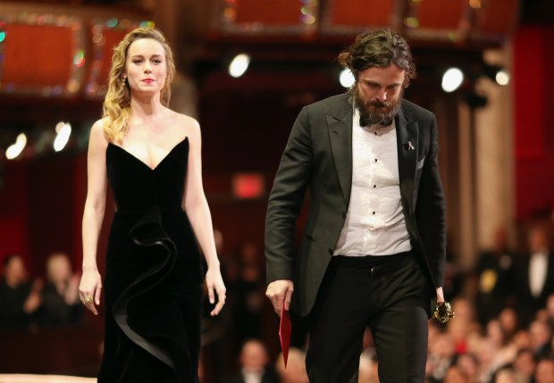 HOLLYWOOD, CA - FEBRUARY 26: Actor Casey Affleck (R) accepts the Best Actor award for 'Manchester by the Sea' from presenter Brie Larson onstage onstagee during the 89th Annual Academy Awards at Hollywood & Highland Center on February 26, 2017 in Hollywood, California. (Photo by Christopher Polk/Getty Images)