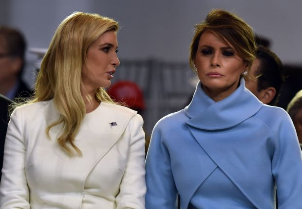 (FILES) This file photo taken on January 20, 2017 shows US First Lady Melania Trump speaking with Ivanka Trump during the presidential inaugural parade for US President Donald Trump in Washington, DC.Two weeks after her husband's inauguration, questions are mounting about what kind of first lady Melania Trump will be. The 46-year-old former model wowed the crowds at his swearing-in ceremony and inaugural balls dressed in Ralph Lauren powder blue and a vanilla crepe, ticking fashion boxes and suggesting that the mother of one was anxious to step up to her new role.Since then, however, she has not been seen at official events, is not living in the White House and is still putting together her staff. / AFP PHOTO / Nicholas KammNICHOLAS KAMM/AFP/Getty Images