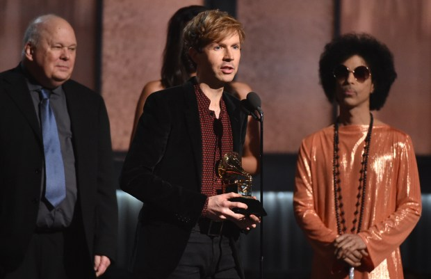 """Beck accepts the award for album of the year for """"Morning Phase"""" at the 57th annual Grammy Awards on Sunday, Feb. 8, 2015, in Los Angeles. (Photo by John Shearer/Invision/AP)"""
