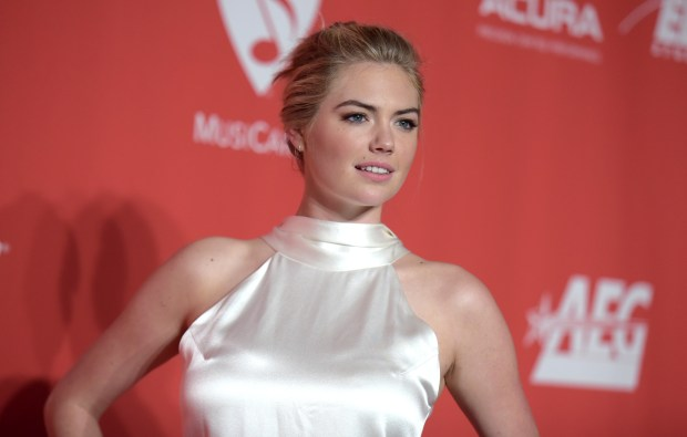 FILE - In this Friday, Feb. 10, 2017 file photo, Kate Upton arrives at the MusiCares Person of the Year tribute honoring Tom Petty at the Los Angeles Convention Center. She's once, twice, three times a Sports Illustrated swimsuit cover lady. Upton once again graces the cover of the annual issue announced Tuesday, Feb. 14, becoming only the fourth woman to ever do it three times. This year, she makes the splash with three different covers. (Photo by Richard Shotwell/Invision/AP, File)