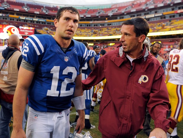 Indianapolis Colts quarterback Andrew Luck and Washington Redskins offensive coordinator Kyle Shanahan meet after an NFL preseason football game Saturday, Aug. 25, 2012, in Landover, Md. The Redskins won 30-17. (AP Photo/Richard Lipski)