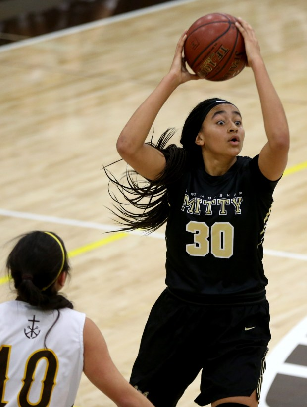 Archbishop Mitty's Haley Jones (30) looks to pass against St. Francis's Paige Uyehara (10) in the first half of a basketball game at St. Francis High School in Mountain View, Calif., on Friday, Feb. 10, 2017. (Ray Chavez/Bay Area News Group)