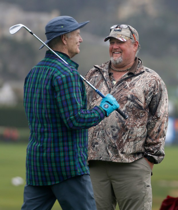 Actor Bill Murray, left, jokes with comedian, Larry the Cable Guy, on the 18th green during the AT&T Pro-Am Celebrity Challenge at Pebble Beach Golf Links in Pebble Beach, Calif., Wednesday, Feb. 8, 2017. (Patrick Tehan/Bay Area News) Group)