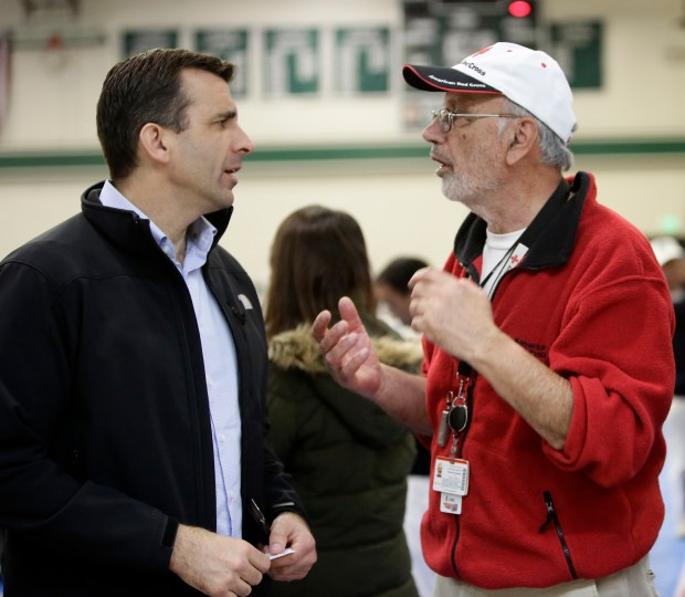 San Jose Mayor Sam Liccardo talks with Red Cross volunteer Mo Ghandehari, right, at the overnight shelter for the flood evacuees at James Lick High School Gymnasium in San Jose in Feb. 21, 2017. (Josie Lepe/Bay Area News Group)
