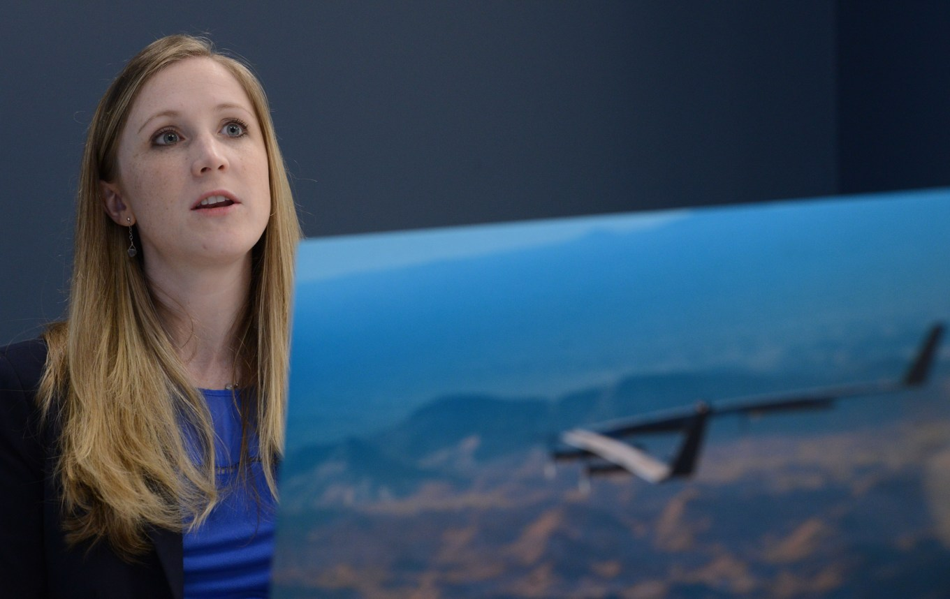 "Kathryn Cook, technical program manager for Facebook, is photographed with a picture of the prototype for ""Aquila"" in Menlo Park, Calif., on Friday, Feb. 3, 2017. Aquila is a drone being developed by the company's connectivity lab to deliver internet to remote areas. (Dan Honda/Bay Area News Group)"