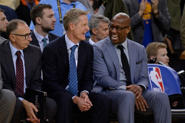 Golden State Warriors head coach Steve Kerr shares a laugh with assistant coach Mike Brown during the fourth quarter of their NBA game against the Los Angeles Clippers at the Oracle Arena in Oakland, Calif. on Thursday, Feb. 23, 2017. The Warriors defeated the Clippers 123-113. (Jose Carlos Fajardo/Bay Area News Group)