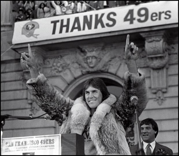 Forty Niners reciever Dwight Clark raises his arms to a San Francisco City Hall crowd after a parde down Market Street in January 1982. The Forty Niners won SuperBowl 16 in Pontiac Michigan over Cincinnati, 26-21. (PHOTO BY BOB LARSON/ UNITED PRESS INTERNATIONAL)