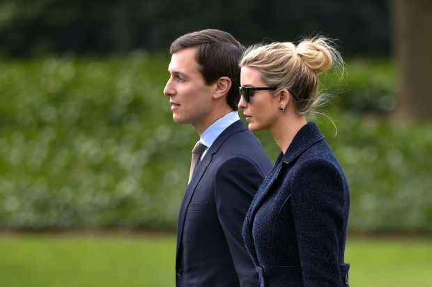 Senior Advisor to the President, Jared Kushner (L), walks with his wife Ivanka Trump to board Marine One at the White House in Washington, DC, on March 3, 2017. The two are travelling with US President Donald Trump to Florida. / AFP PHOTO / MANDEL NGAN