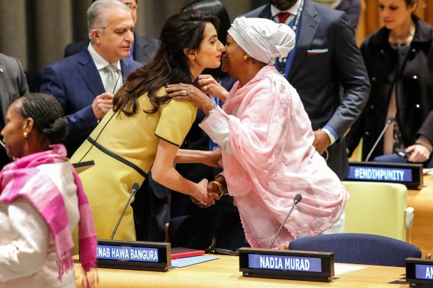 "Amal Clooney, Legal Representative for Nadia Murad and other Yazidi survivors, speaks with Zainab Bengura, UN Special Representative on Sexual Violence in Conflict, as they attend ""The Fight against Impunity for Atrocities: Bringing Da'esh to Justice"" at the United Nations Headaquarters on March 9, 2017 in New York. / AFP PHOTO / KENA BETANCUR (Photo credit should read KENA BETANCUR/AFP/Getty Images)"