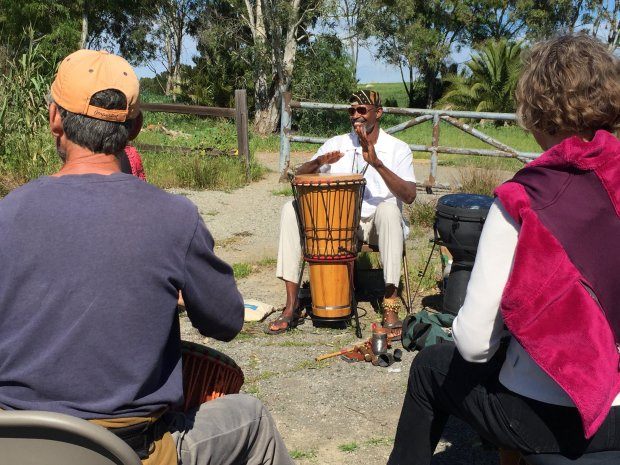 ANGELA HILL/STAFFDrummer Michael Fair leads a Spring Equinox drum circle at Bedwell Bayfront Park in Menlo Park.