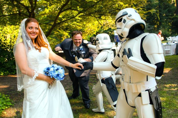 """COURTESY RIKA ITAMI/CALMAX STUDIOStormtroopers from the Golden Gate Garrison of the 501st Legion, a tight-knit community of """"Star Wars"""" costumers, kept things under control at the 2015 wedding of Michelle and Justin Berger in the Santa Cruz Mountains. Trooper Diana Torres held back the groom."""