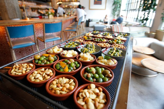 Spiced almonds, marinated olives, and cheese, are among items served from the pincho cart at the Bellota restaurant on Wednesday, March 15, 2017, in San Francisco Calif. (Aric Crabb/Bay Area News Group)