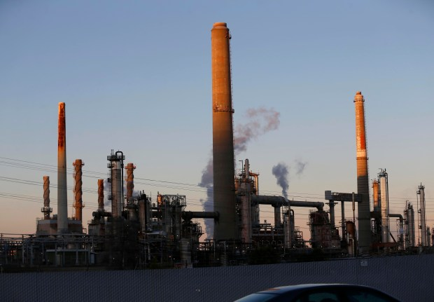The Shell Refinery is seen as the sun sets in Martinez, Calif., on Thursday, March 3, 2017. A widespread odor of natural gas was caused by a chemical delivery at a refinery earlier in the day, officials said. No leaks and no health impacts were recorded. (Jane Tyska/Bay Area News Group)
