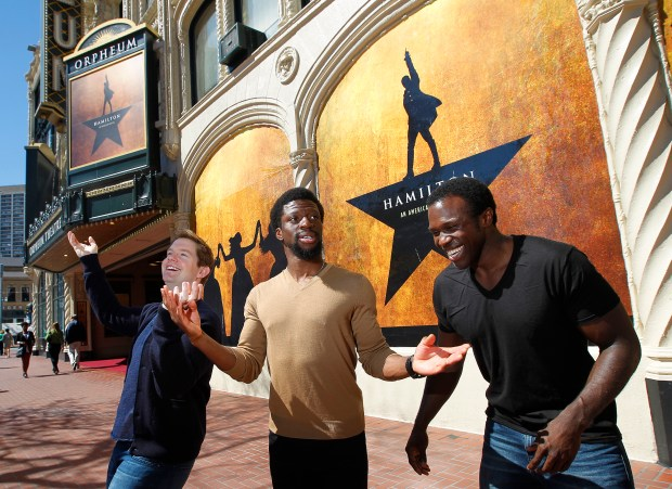 """Actors Rory O'Malley, left, Michael Luwoye, center, and Joshua Henry, right, pose for a photograph in front of the Orpheum Theatre on Tuesday, March 14, 2017, in San Francisco, Calif. The trio stars in the musical """"Hamilton"""". (Aric Crabb/Bay Area News Group)"""