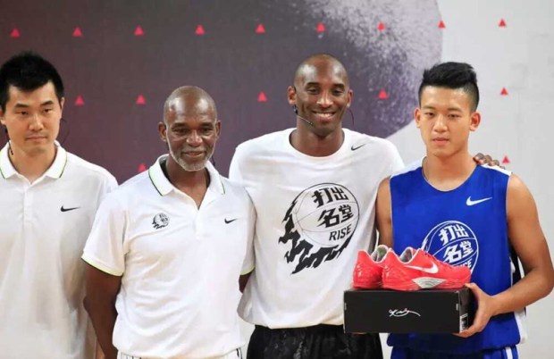 Eastside Prep girls basketball coach Donovan Blythe, second from left, stands next to retired NBA star Kobe Bryant at a Nike RISE Camp in China. (Courtesy photo)