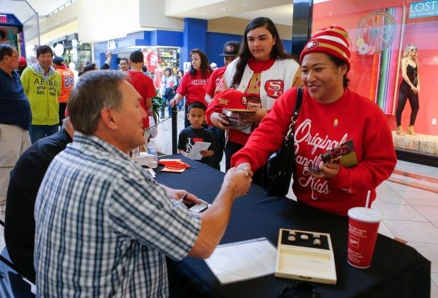 Fans meet San Francisco 49er's legend Dwight Clark at Serramonte Shopping Center in Daly City, Calif., on Saturday April 5, 2014. (John Green/Bay Area News Group)