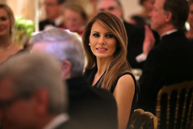 WASHINGTON, DC - FEBRUARY 26: (AFP OUT) U.S. first lady Melania Trump listens to a toast by her husband President Donald Trump while hosting the annual Governors' Dinner in the East Room of the White House February 26, 2017 in Washington, DC. Part of the National Governors AssociationÕs annual meeting in the nation's capital, the black tie dinner and ball is the first formal event the Trumps will host at the White House since moving in last month. (Photo by Chip Somodevilla/Getty Images)