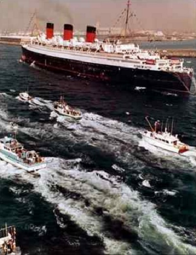 This photo, taken from the Goodyear Blimp by photographer Roger Coar, shows the Queen Mary arriving in the Port of Long Beach on Dec. 9, 1967. Purchased for $3.45 million and refurbished for an additional $55 million, the Queen Mary remains a landmark in Long Beach. (File photo, Roger Coar)