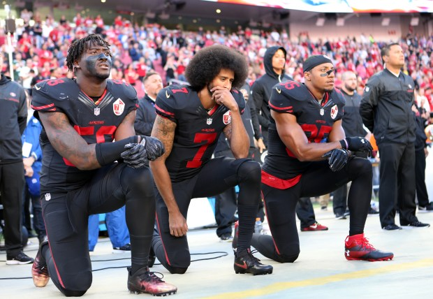 From left to right, San Francisco 49ers' Eli Harold (58), San Francisco 49ers quarterback Colin Kaepernick (7) and San Francisco 49ers' Eric Reid (35) kneel during the national anthem before their NFL game against Arizona Cardinals at Levi's Stadium in Santa Clara, Calif., on Thursday, Oct. 6, 2016. (Josie Lepe/Bay Area News Group)