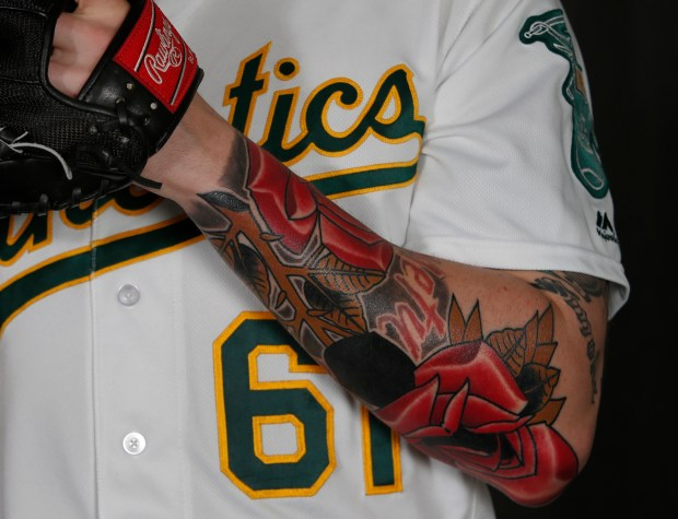 Oakland Athletics relief pitcher John Axford shows off his recently tattooed arm during the team's photo day Wednesday, Feb. 22, 2017, at Hohokam Stadium in Mesa, Az. (Karl Mondon/Bay Area News Group)