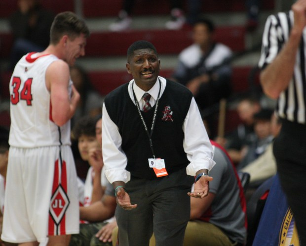 James Logan coach Melvin Easley pleads with the refereee as his team plays Palo Alto in the second quarter during the Northern California Division I boys basketball championship game at Santa Clara University's Leavey Event Center Saturday, March 18, 2017, in Santa Clara, Calif. (Jim Gensheimer/Bay Area News Group)
