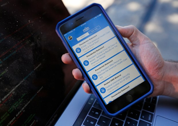 Ash Bhat shows how the Presidential Actions app works in Sproul Plaza on the UC Berkeley campus in Berkeley, Calif., on Monday, March 13, 2017. Bhat and Rohan Pai, both students at UC Berkeley have created the Presidential Actions app that helps users keep up with presidential Executive orders, memorandums, proclamations and any official actions taken by the president. (Laura A. Oda/Bay Area News Group)