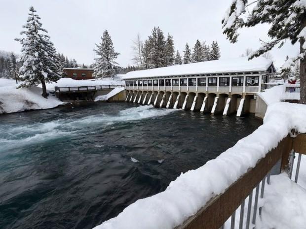 Water from Lake Tahoe flows into the Truckee River through the dam at Tahoe City, Calif., in this photo taken on Feb. 23, 2017. The drought-busting snow and rain in the mountains around Tahoe have pushed the lake's level to its highest mark in more than a decade. (Jason Bean /The Reno Gazette-Journal via AP)