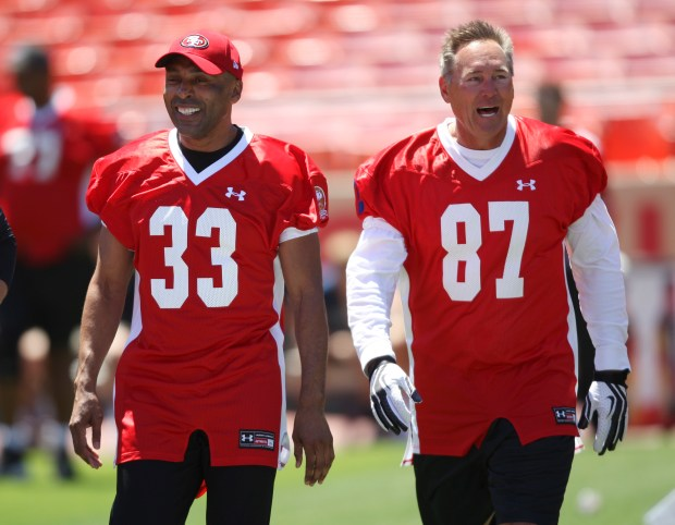 Roger Craig, left, and Dwight Clark wait their turn to get the ball during practice for Legends of Candlestick at Candlestick Park in San Francisco, Calif., on Friday, July 11, 2014. Former 49ers will play a team of former NFL all-stars in a game of flag football on Saturday, July 12, 2014. It is being billed as the last football game ever at Candlestick Park. (Jim Gensheimer/Bay Area News Group)