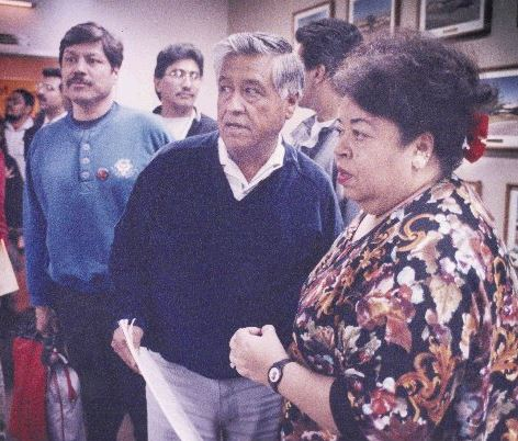 United Farm Workers of America founder Cesar Chavez, center, is briefed by Sofia Mendoza, of the Family Services Association of Santa Clara Valley, before Chavez addressed the Human Relations Commission in 1991. The hearing was sparked by community outrage regarding a Mercury News series about Hispanic gangs in east San Jose. -- SLUG: cesar.2.jpg PHOTO DATE: 1991 SCAN DATE: 12/20/2006 CREDIT: Michael Rondou