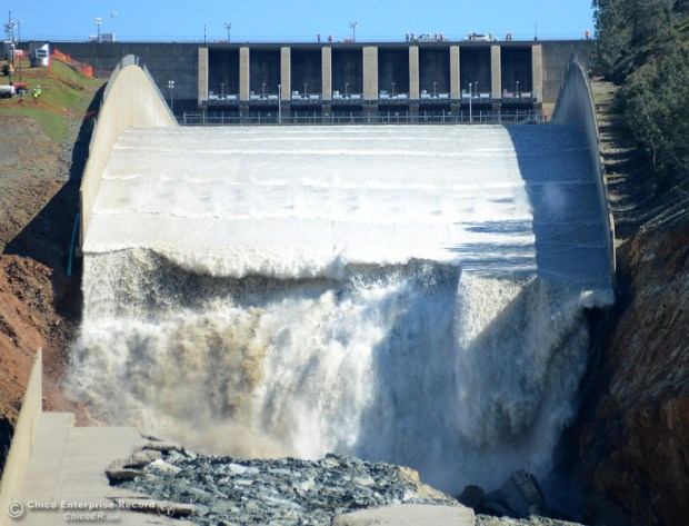 Water begins to pour down the Oroville Dam spillway as flows are increased Friday, March 17, 2017, to 50,000 cubic feet per second in Oroville, California. (Dan Reidel -- Enterprise-Record)