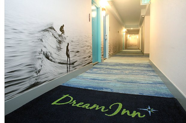 Surfers ride waves along the hallways in the newly remodeled Dream Inn. (Dan Coyro -- Santa Cruz Sentinel)