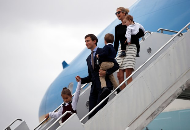 Arabella Kushner, her father White House senior adviser Jared Kushner, carrying Joseph Kushner, Ivanka Trump, carrying Theodore Kushner, step off Air Force One at the Palm Beach International Airport, Friday, March 3, 2017, in West Palm Beach, Fla. (AP Photo/Alex Brandon)
