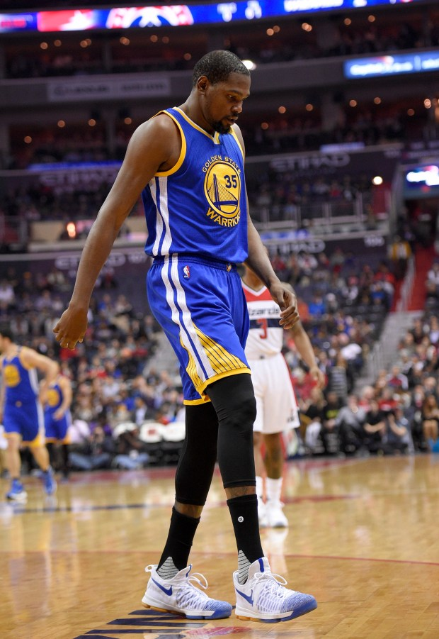 Golden State Warriors forward Kevin Durant (35) walks to the bench during the first half of an NBA basketball game against the Washington Wizards, Tuesday, Feb. 28, 2017, in Washington. Durant hyperextended his left knee and exited the Golden State Warriors' game at the Washington Wizards for good after all of 93 seconds Tuesday night. (AP Photo/Nick Wass)