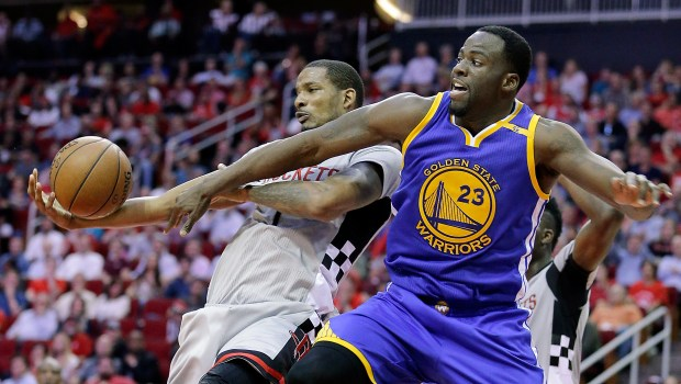Houston Rockets' Trevor Ariza (1) and Golden State Warriors' Draymond Green (23) battle for a rebound in the second half of an NBA basketball game in Houston, Tuesday, March 28, 2017. (AP Photo/Michael Wyke)