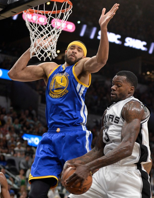 San Antonio Spurs center Dewayne Dedmon, right, grabs the rebound against Golden State Warriors center JaVale McGee during the first half of an NBA basketball game, Wednesday, March 29, 2017, in San Antonio. (AP Photo/Darren Abate)