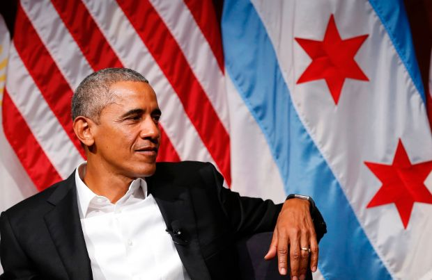 Former US President Barack Obama attends a forum with young leaders to discuss community organizing an at the University of Chicago in Chicago / AFP PHOTO / JIM YOUNGJIM YOUNG/AFP/Getty Images