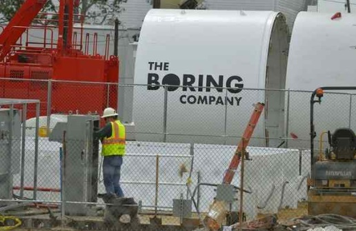 """Sections of a tunnel-boring machine are being worked on in a parking lot along Crenshaw Blvd. across the street from SpaceX in Hawthorne on Thursday, April 27, 2017. """"The Boring Company"""" name already has been applied. (Photo by Scott Varley, Daily Breeze/SCNG)"""