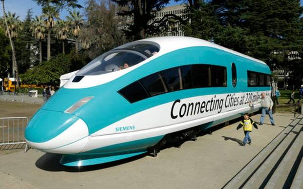 This Feb. 26, 2015, photo shows a full-scale mock-up of a high-speed train, displayed at the Capitol in Sacramento, Calif. Sacramento County Superior Court Judge Raymond Cadei said in a tentative ruling, Tuesday, April 25, 2017, that he intends to dismiss a lawsuit by opponents that would have blocked the California High Speed Rail Authority from spending about $1.25 billion in bonds sold last week. (Rich Pedroncelli, File AP Photo)