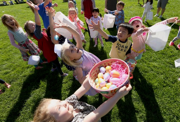 Children scramble for prize-filled eggs tossed in the air during the Piedmont Recreation Department's annual Bunny Blast egg hunt in Piedmont, Calif., on Saturday, April 1, 2017. (Anda Chu/Bay Area News Group)