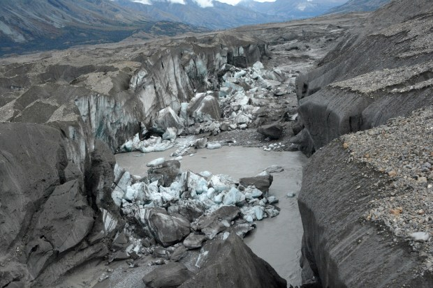 A close-up view of the ice-walled canyon at the terminus of the Kaskawulsh Glacier, with recently collapsed ice blocks, in 2016. (Jim Best/University of Illinois via AP)