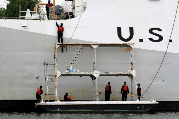 A crew works on the hull of the Coast Guard Cutter Waesche while the ship is docked at Coast Guard Island in Alameda, Calif., on Tuesday, April 11, 2017. (Laura A. Oda/Bay Area News Group)