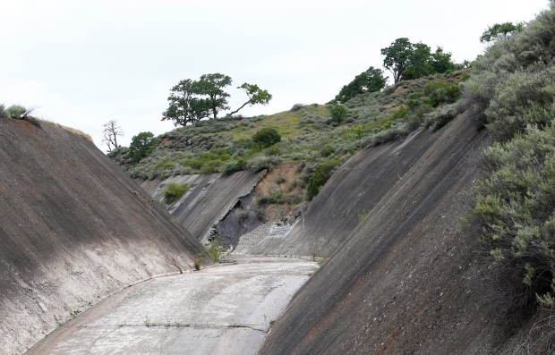Damage to the spillway of the North Fork Dam, built in the 1930s on Pacheco Creek, is evident in the hills of Eastern Santa Clara County near Hollister, Calif., on Tuesday, April 11, 2017. The Santa Clara Valley Water District, San Benito County Water District, and the dam's owner, Pacheco Pass Water District, are studying whether to build a much larger reservoir at the site. The spillway on the existing reservoir was damaged in winter storms and has been required to be fixed by state dam regulators. (Gary Reyes/ Bay Area News Group)