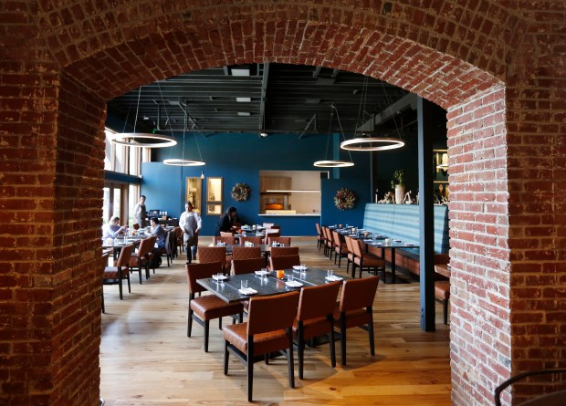 Dining area photographed at Vina Enoteca restaurant in Palo Alto, Calif., Wednesday, April 12, 2017. (Patrick Tehan/Bay Area News Group)