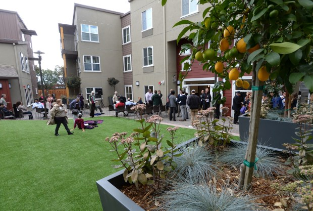 People mill about in the courtyard at the grand opening of Arboleda Apartments, a project built by Satellite Affordable Housing Associates in Walnut Creek, Calif., on Thursday, May 14, 2015. Arboleda provides permanent affordable housing for households whose income is at or below 50 percent of the area median. (Susan Tripp Pollard/Bay Area News Group)